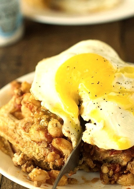 Chili and cornbread waffle stacks with an egg on top